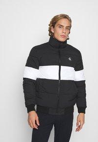 Calvin Klein Jeans - OUTLINE LOGO JACKET - Winter jacket - black - 0
