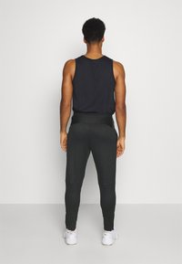 Nike Performance - PANT CAPRA - Tracksuit bottoms - black/iron grey - 2