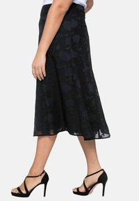 Sheego - A-line skirt - black - 3