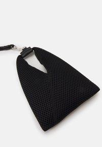 MM6 Maison Margiela - ORNAMENTAL ITEM - Handbag - black - 4
