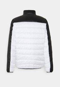 Calvin Klein - MULTI QUILT WADDED JACKET - Light jacket - white - 1