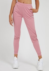 Guess - SPORTHOSE - Tracksuit bottoms - rose - 0
