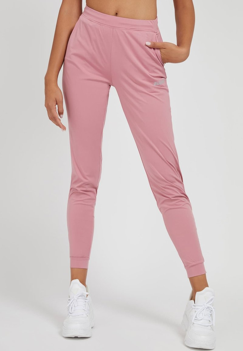Guess - SPORTHOSE - Tracksuit bottoms - rose