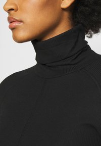 Weekday - CAROL TURTLENECK - T-shirt à manches longues - black - 5