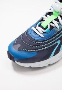 Nike Sportswear - AIR MAX 270 REACT ENG - Sneakers - blackened blue/green strike/pure platinum/team royal/blue fury/aura - 6