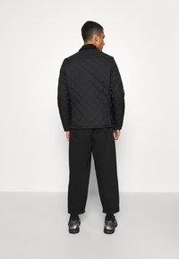 Barbour Beacon - STARLING QUILT - Light jacket - black - 2