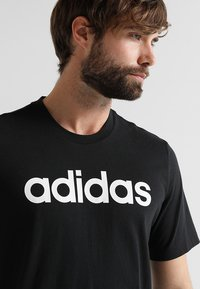 adidas Performance - LIN TEE - T-Shirt print - black/white - 4