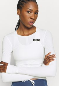 Puma - PAMELA REIF X PUMA COLLECTION RUSHING - Sports shirt - star white - 6