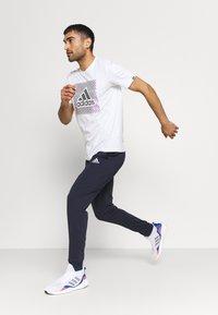adidas Performance - Tracksuit bottoms - legend ink - 1