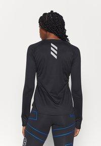 adidas Performance - REFLECTIVE - Sports shirt - black - 2