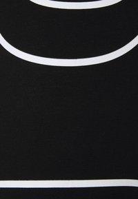 DKNY - 7/8 EXPLODED LOGO LEGGING - Leggings - black - 2