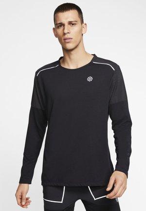 RISE HYBRID - Sports shirt - black