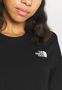 The North Face - INTERNATIONAL WOMENS DAY TEE - T-shirts print - black - 4