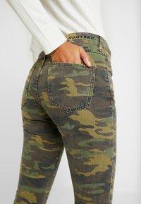 NGHTBRD - MILITARY MOONCHILD - Slim fit jeans - coloured denim/khaki - 4