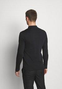 Selected Homme - SLHPARIS  - Polo shirt - black - 2