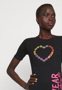 GCDS - ELEMENTS DRESS - Jersey dress - black - 3