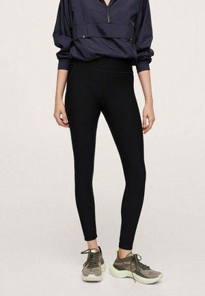 TÉCNICOS COMPRESIVOS - Leggings - Trousers - black