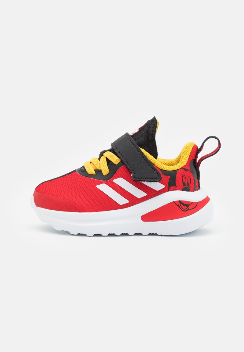 adidas Performance - FORTARUN MICKEY UNISEX - Neutral running shoes - core black/footwear white/vivid red