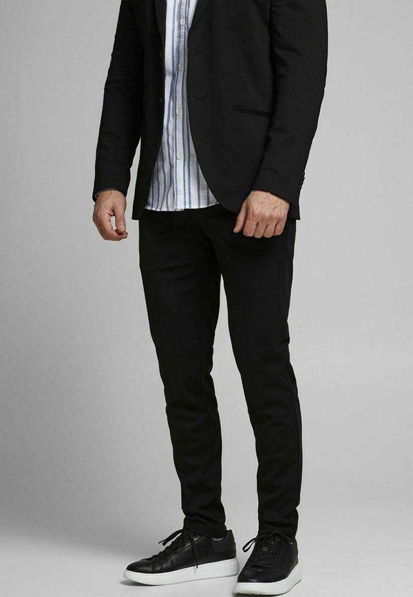 Produkt PHIL - Chinosy - black/czarny Odzież Męska XRVZ