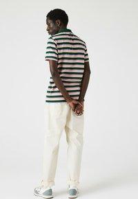 Lacoste - Polo shirt - grün/ blau/ rosa/ beige/weiß - 1
