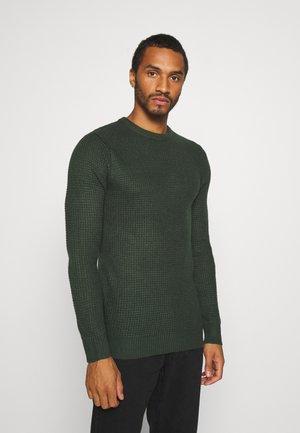 Stickad tröja - army green
