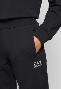 EA7 Emporio Armani - TROUSER - Spodnie treningowe - black - 5