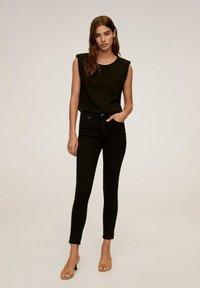 Mango - ISA - Jeans Skinny Fit - black - 0