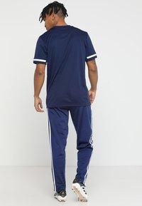 adidas Performance - TIRO - Spodnie treningowe - darkblue/white - 2