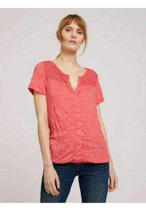 T-shirts print - strong peach tone