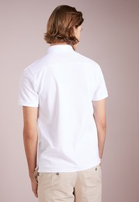 J.LINDEBERG - TROY CLEAN - Poloshirt - white - 2