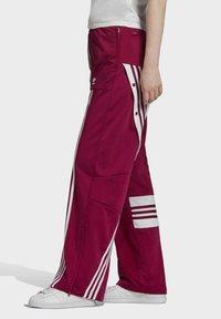 adidas Originals - DANIËLLE CATHARI JOGGERS - Joggebukse - purple - 2