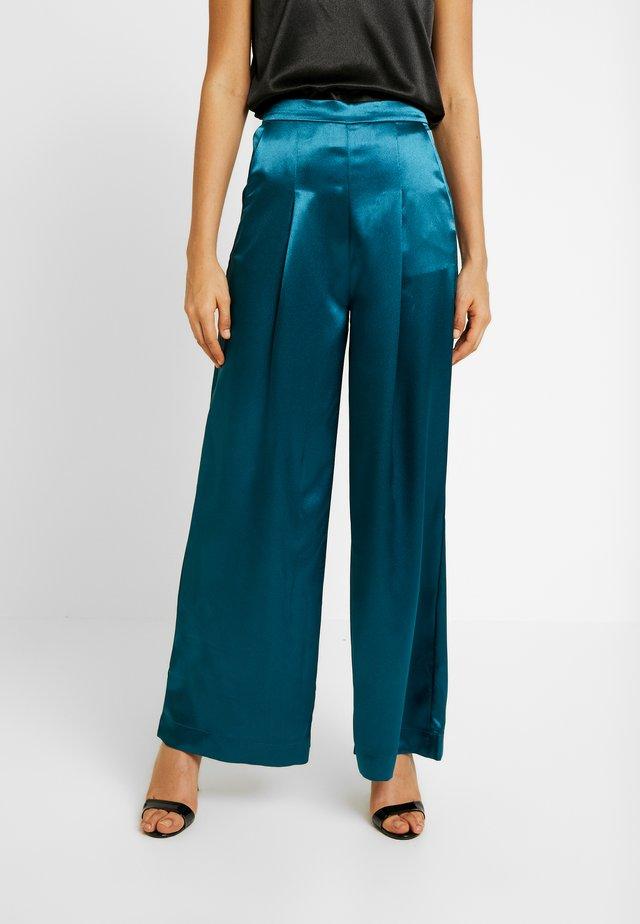 MANABA TROUSERS - Trousers - petrol/grün
