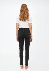 ARMEDANGELS - INGAA - Slim fit jeans - washed down black - 2