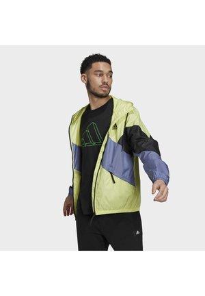 WIND.RDY - Waterproof jacket - yellow