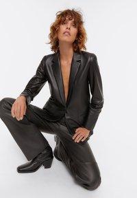 Uterqüe - Leather jacket - black - 5