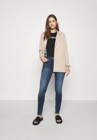 Calvin Klein Jeans - MID RISE  - Skinny-Farkut - mid blue - 1
