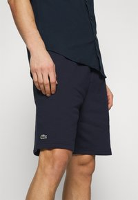 Lacoste - Tracksuit bottoms - navy blue - 3