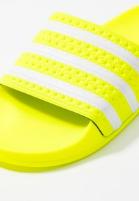 adidas Originals - ADILETTE - Mules - solar yellow/footwear white - 5