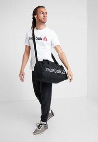 Reebok - ACT CORE GRIP - Sports bag - black/medium grey - 1