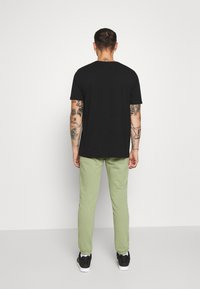 Diesel - PETER TROUSERS - Tracksuit bottoms - olive - 2