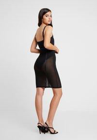 Good American - SHEER CONTOUR DRESS - Cocktail dress / Party dress - black - 4