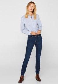 Esprit - LIEBLINGS GESCHNITTENE  - Slim fit jeans - blue dark washed - 1