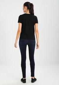 Wood Wood - UMA - Print T-shirt - black - 2