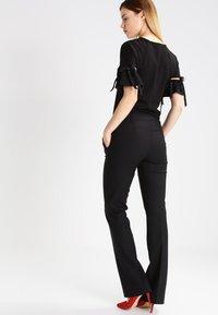 KIOMI - Spodnie materiałowe - black - 3