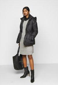 Vero Moda Petite - VMSOHO JACKET - Winter jacket - black - 1