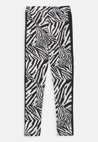 Puma - CLASSICS SAFARI LEGGINGS - Leggings - white/black - 1