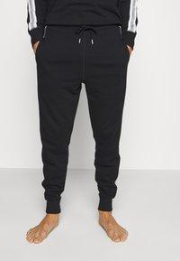 Diesel - UMLB-PETER TROUSERS - Pantaloni del pigiama - black - 0