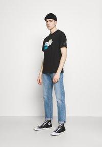 Tommy Jeans - FADED GRAPHIC TEE UNISEX - Triko spotiskem - black - 1