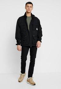 Zalando Essentials - Slim fit jeans - black denim - 1