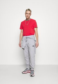 The North Face - JOGGER - Tracksuit bottoms - light grey heather - 1